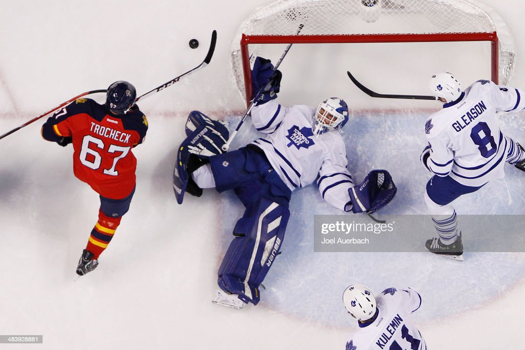 <a gi-track='captionPersonalityLinkClicked' href=/galleries/search?phrase=Vincent+Trocheck&family=editorial&specificpeople=6675079 ng-click='$event.stopPropagation()'>Vincent Trocheck</a> #67 of the Florida Panthers skates after the puck after Goaltender Drew MacIntyre #35 of the Toronto Maple Leafs makes a save in the second period at the BB&T Center on April 10, 2014 in Sunrise, Florida. The Panthers defeated the Maple Leafs 4-2.