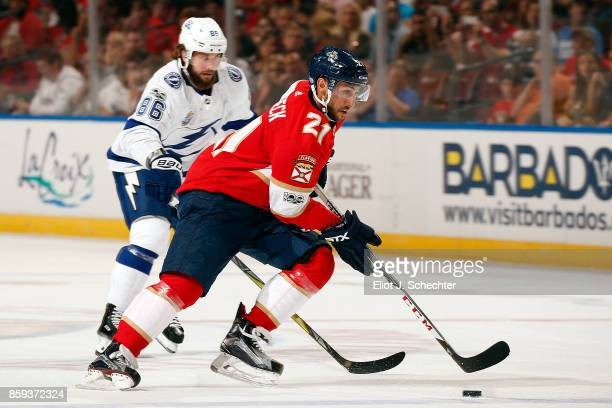 Vincent Trocheck of the Florida Panthers skates with the puck against Nikita Kucherov of the Tampa Bay Lightning at the BBT Center on October 7 2017...
