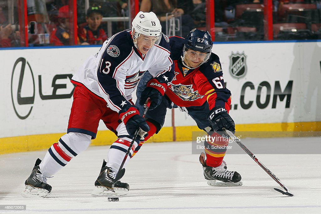 Vincent Trocheck #67 of the Florida Panthers tangles with Cam Atkinson #13 of the Columbus Blue Jackets at the BB&T Center on April 12, 2014 in Sunrise, Florida.