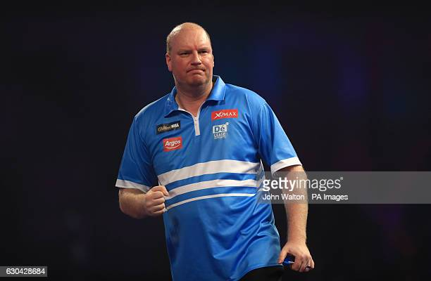 Vincent van der Voort celebrates taking the first set against Max Hopp during day eight of the William Hill World Darts Championship at Alexandra...