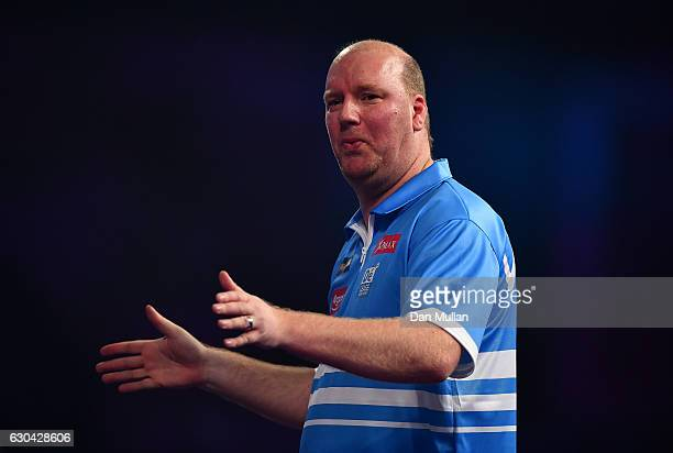 Vincent van der Voort of the Netherlands reacts during his first round match against Max Hopp of Germnay on day eight of the 2017 William Hill PDC...