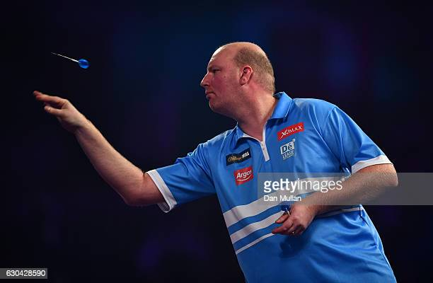 Vincent van der Voort of the Netherlands throws during his first round match against Max Hopp of Germnay on day eight of the 2017 William Hill PDC...