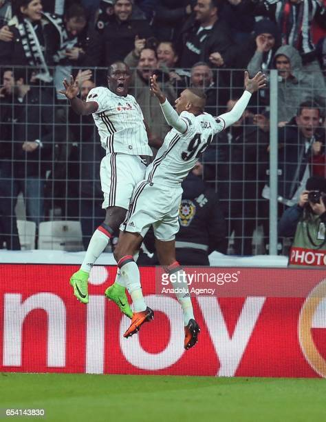 Vincente Aboubakar of Besiktas celebrates with Talisca after scoring during the UEFA Europa League Round 16 secondleg match between Besiktas and...