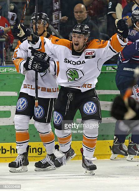 Vincenz Mayer of Wolfsburg jubilates after scoring the first goal during the DEL match between EHC Eisbaeren Berlin and Grizzly Adams Wolfsburg at O2...