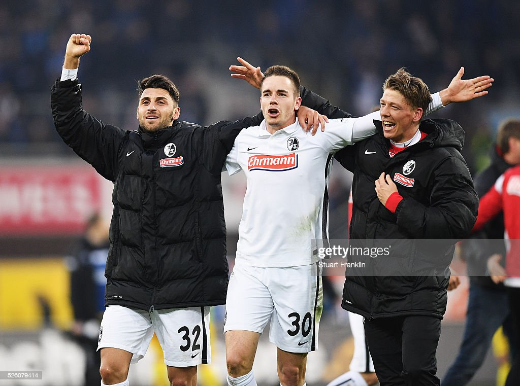 Vincenzo Grifo, Christian G��nter and Florian Niederlechner of Freiburg celebrate promotion to the first Bundesliga after the second Bundesliga match between SC Paderborn and SC Freiburg at the Benteler Arena on April 29, 2016 in Paderborn, North Rhine-Westphalia.
