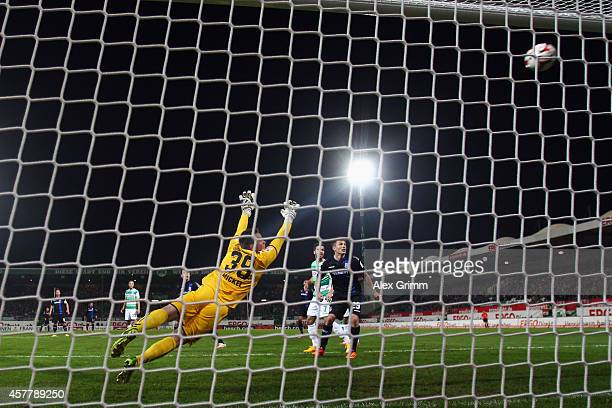 Vincenzo Grifo of Frankfurt scores his team's third goal against goalkeeper Tom Mickel of Greuther Fuerth during the Second Bundesliga match between...