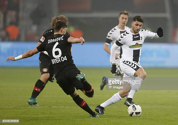 Vincenzo Grifo of Freiburg and Aleksandar Dragovic of Leverkusen battle for the ball during the Bundesliga match between Bayer 04 Leverkusen and SC...