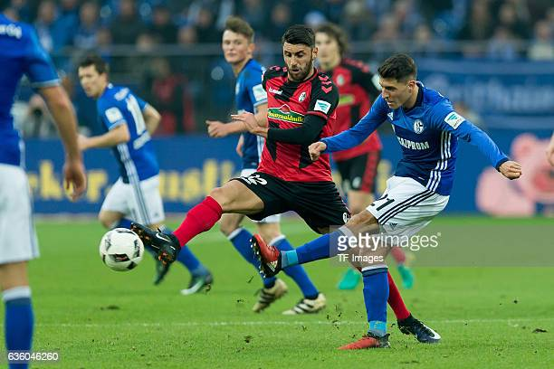 Vincenzo Grifo of Freiburg and Alessandro Schoepf of Schalke battle for the ball during the Bundesliga match between FC Schalke 04 and SC Freiburg at...