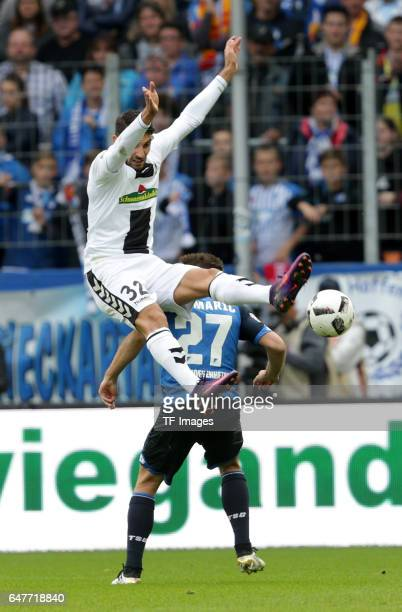 Vincenzo Grifo of Freiburg and Andrej Kramaric of Hoffenheim battle for the ball during the Bundesliga match between TSG 1899 Hoffenheim and SC...