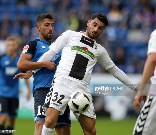 Vincenzo Grifo of Freiburg and Kerem Demirbay of Hoffenheim battle for the ball during the Bundesliga match between TSG 1899 Hoffenheim and SC...