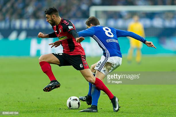 Vincenzo Grifo of Freiburg and Leon Goretzka of Schalke battle for the ball during the Bundesliga match between FC Schalke 04 and SC Freiburg at...