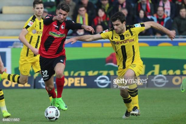 Vincenzo Grifo of Freiburg and Sokratis Papastathpoulos of Dortmund battle for the ball during the Bundesliga match between Sport Club Freiburg and...