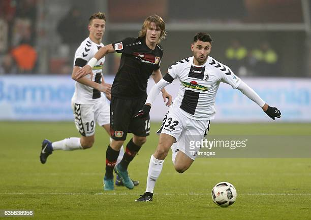 Vincenzo Grifo of Freiburg and Tin Jedvaj of Leverkusen battle for the ball during the Bundesliga match between Bayer 04 Leverkusen and SC Freiburg...