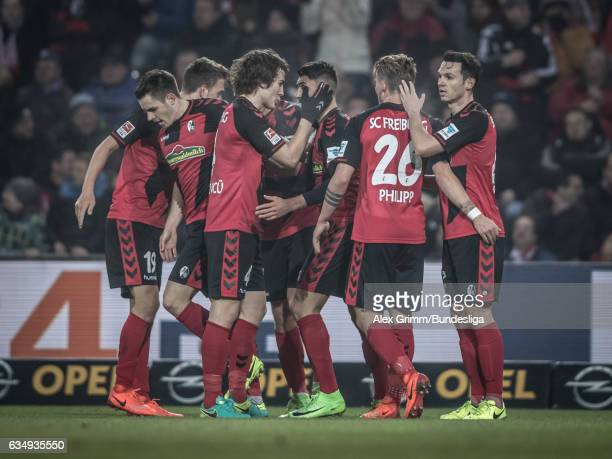 Vincenzo Grifo of Freiburg celebrates his team's first goal with team mates during the Bundesliga match between SC Freiburg and 1 FC Koeln at...