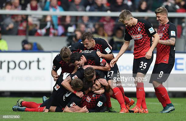 Vincenzo Grifo of Freiburg celebrates with his teammates after scoring his team's third goal during the Second Bundesliga match between SC Freiburg...