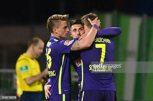 Vincenzo Grifo of Freiburg celebrates with teammates after scoring his team's third goal during the Second Bundesliga match between SpVgg Greuther...