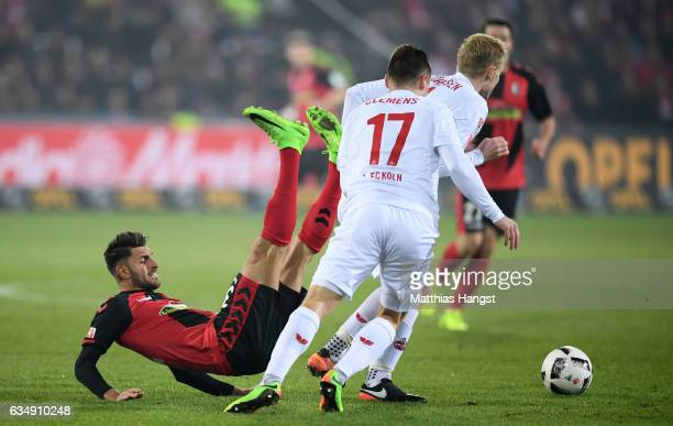 Vincenzo Grifo of Freiburg is challenged by Frederik Soerensen of Koeln during the Bundesliga match between SC Freiburg and 1 FC Koeln at...