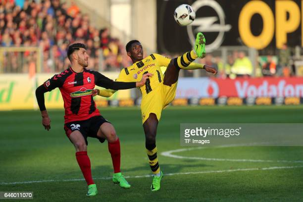 Vincenzo Grifo of Freiburg Ousmane Dembele of Dortmund battle for the ball during the Bundesliga match between Sport Club Freiburg and Borussia...