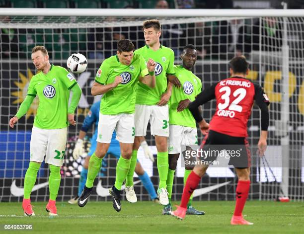 Vincenzo Grifo of Freiburg takes a free kick against a wall of Wolfsburg player during the Bundesliga match between VfL Wolfsburg and SC Freiburg at...