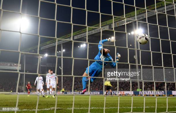 Vincenzo Grifo of Freiburgscores his teams first goal against Thomas Kessler of Koeln during the Bundesliga match between SC Freiburg and 1 FC Koeln...