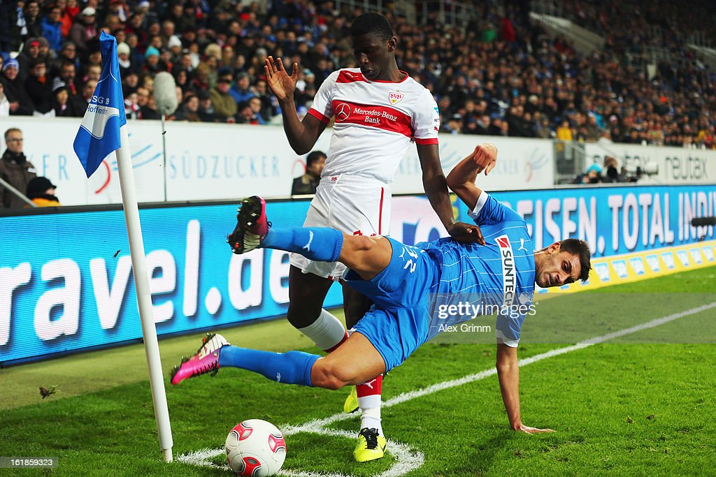Vincenzo Grifo (front) of Hoffenheim is challenged by Antonio Ruediger of Stuttgart during the Bundesliga match between TSG 1899 Hoffenheim and VfB Stuttgart at Rhein-Neckar-Arena on February 17, 2013 in Sinsheim, Germany.
