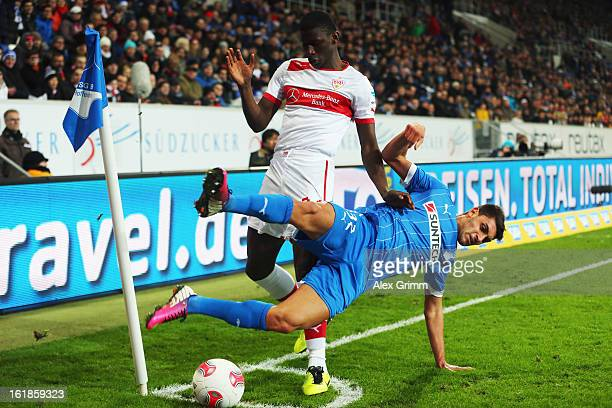 Vincenzo Grifo of Hoffenheim is challenged by Antonio Ruediger of Stuttgart during the Bundesliga match between TSG 1899 Hoffenheim and VfB Stuttgart...