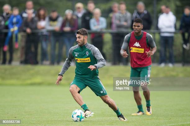 Vincenzo Grifo of Moenchengladbach controls the ball next to Denis Zakaria during Training Session on July 2 2017 in Moenchengladbach Germany
