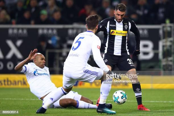 Vincenzo Grifo of Moenchengladbach fights for the bad with Naldo of Schalke and Matija Nastasic of Schalke during the Bundesliga match between...