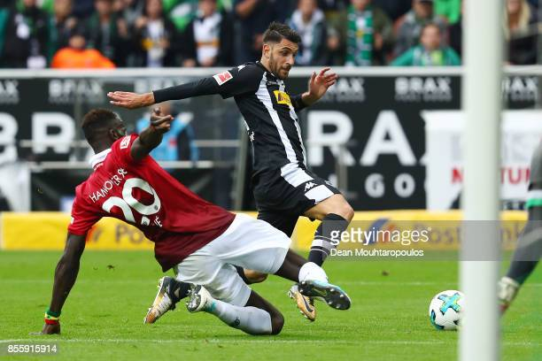 Vincenzo Grifo of Moenchengladbach is being fouled by Salif Sane of Hannover which results in a penalty during the Bundesliga match between Borussia...