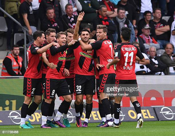 Vincenzo Grifo of SC Freiburg celebrates his opening goal together with teammates during the Bundesliga match between Sport Club Freiburg and...