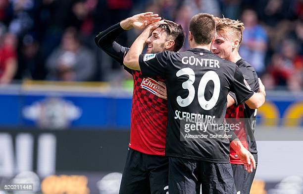 Vincenzo Grifo of SC Freiburg celebrates the second goal for his team with Maximilian Philipp of SC Freiburg and Christian Guenter of SC Freiburg...