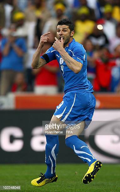 Vincenzo Iaquinta of Italy celebrates after scoring his team's first goal during the 2010 FIFA World Cup South Africa Group F match between Italy and...