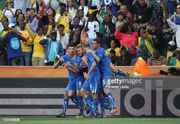 Vincenzo Iaquinta of Italy celebrates with team mates after he scores from the penalty spot during the 2010 FIFA World Cup South Africa Group F match...