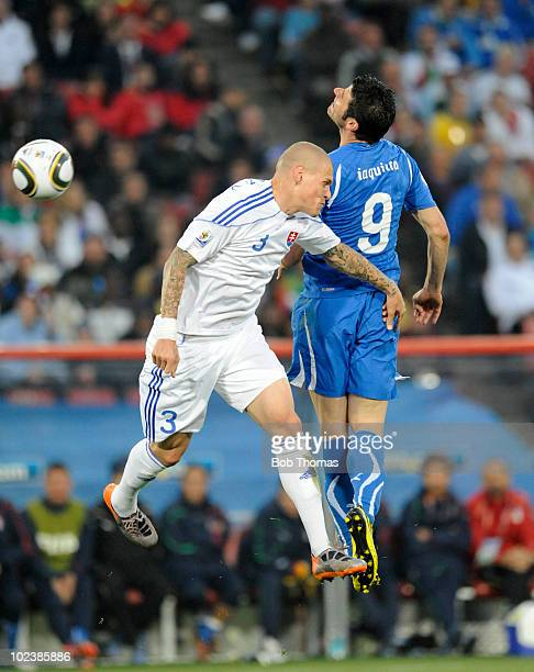 Vincenzo Iaquinta of Italy heads the ball with Domenico Criscito of Slovakia during the 2010 FIFA World Cup South Africa Group F match between...