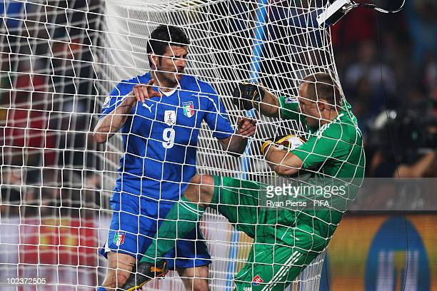 Vincenzo Iaquinta of Italy tussles with goalkeeper Jan Mucha of Slovakia during the 2010 FIFA World Cup South Africa Group F match between Slovakia...