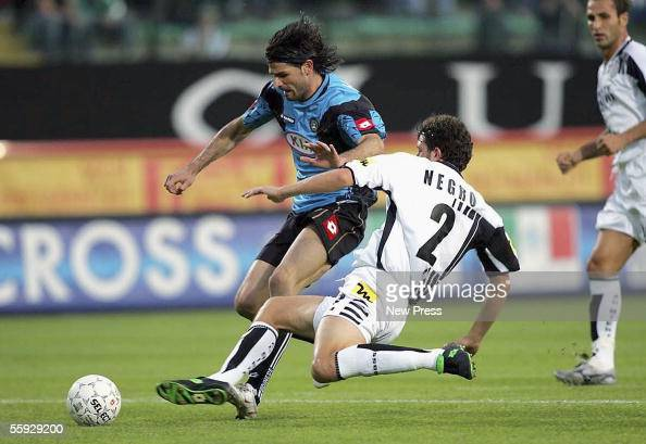 Vincenzo Iaquinta of Udinese competes with Paolo Negro during the Serie A match between Siena and Udinese at the Comunale Artemio Franchi Stadium on...