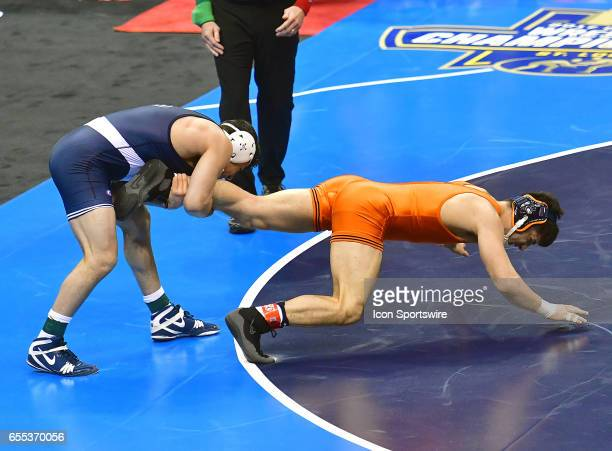Vincenzo Joseph of Penn State has Isaac Martinez of Illinois by his leg in the finals of the 165pound weight class of the NCAA Wrestling...