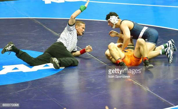 Vincenzo Joseph of Penn State pins Isaiah Martinez of Illinois in the finals of the 165pound weight class of the NCAA Wrestling Championships on...