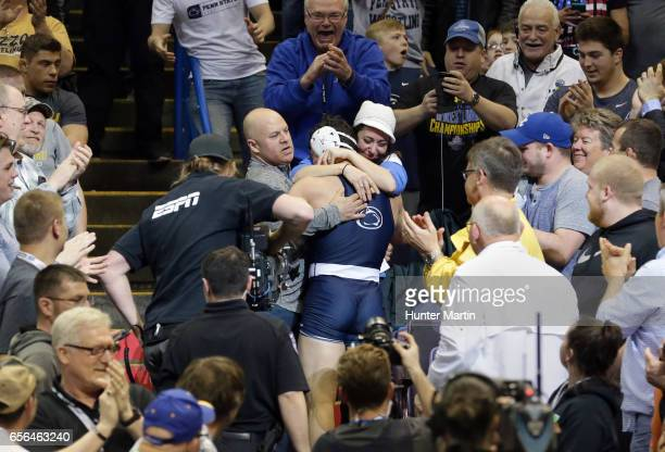Vincenzo Joseph of the Penn State Nittany Lions celebrates with his parents after winning the 165 pound title during the championship finals of the...