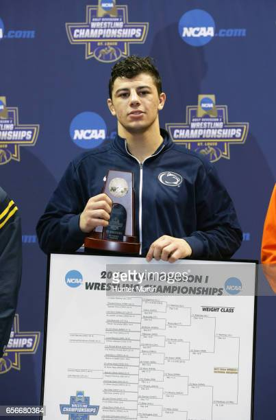 Vincenzo Joseph of the Penn State Nittany Lions stands on the awards podium after winning the 165 pound title during the championship finals of the...