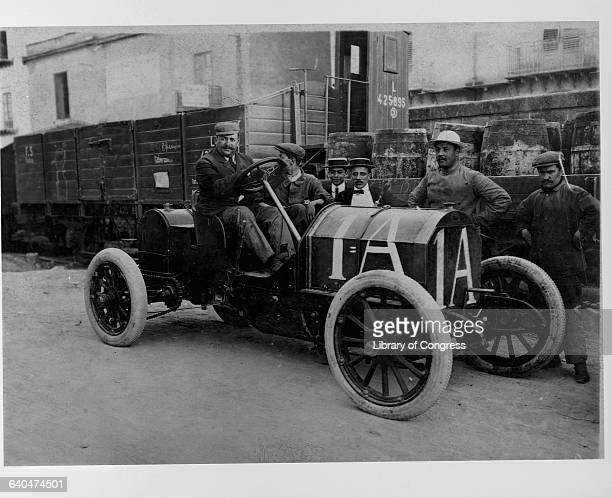 Vincenzo Lancia sits in a Fiat racecar at the 1908 Targa Florio auto race