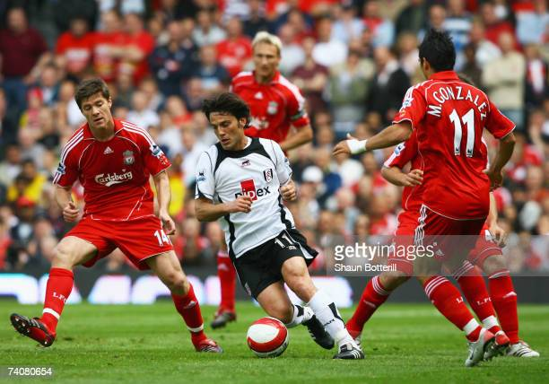Vincenzo Montella of Fulham is watched by Xabi Alonso and Mark Gonzalez of Liverpool during the Barclays Premiership match between Fulham and...