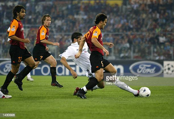 Vincenzo Montella of Roma is tackled by Fernando Hierro of Real Madrid during the UEFA Champions League First Phase Group C match between AS Roma and...