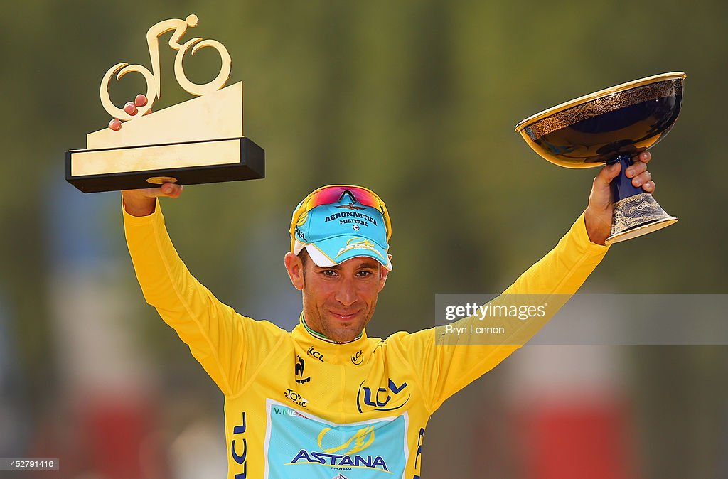 <a gi-track='captionPersonalityLinkClicked' href=/galleries/search?phrase=Vincenzo+Nibali&family=editorial&specificpeople=770634 ng-click='$event.stopPropagation()'>Vincenzo Nibali</a> of Italy and Astana Pro Team celebrates victory in the yellow jersey on the podium following the twenty first stage of the 2014 Tour de France, a 138km stage from Evry into the Champs-Elysees, on July 27, 2014 in Paris, France.