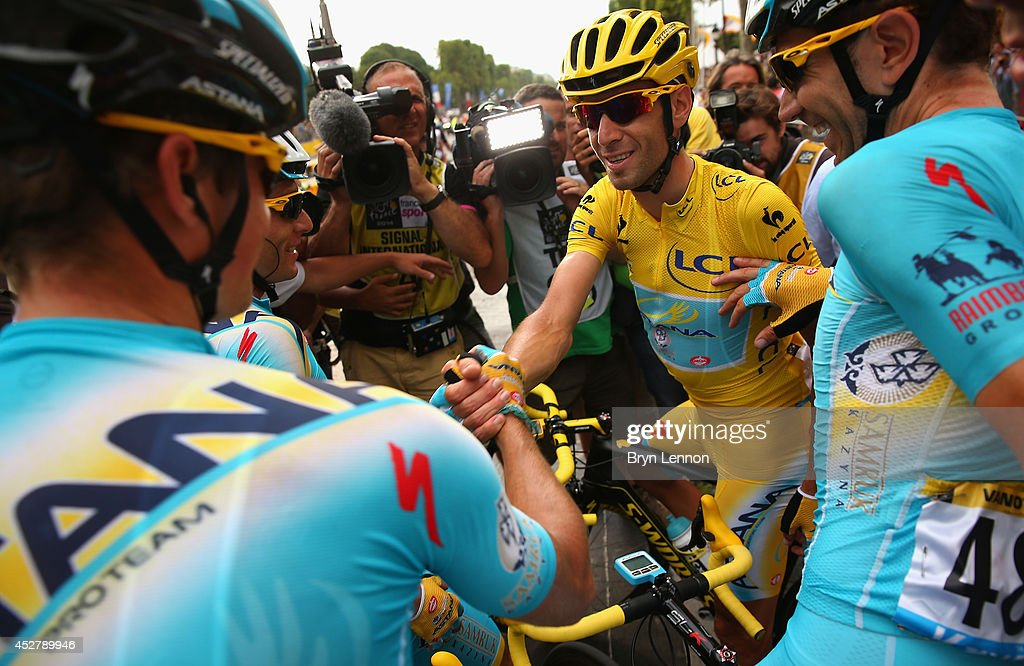 <a gi-track='captionPersonalityLinkClicked' href=/galleries/search?phrase=Vincenzo+Nibali&family=editorial&specificpeople=770634 ng-click='$event.stopPropagation()'>Vincenzo Nibali</a> of Italy and Astana Pro Team celebrates victory with his team-mates following the twenty first stage of the 2014 Tour de France, a 138km stage from Evry into the Champs-Elysees, on July 27, 2014 in Paris, France.