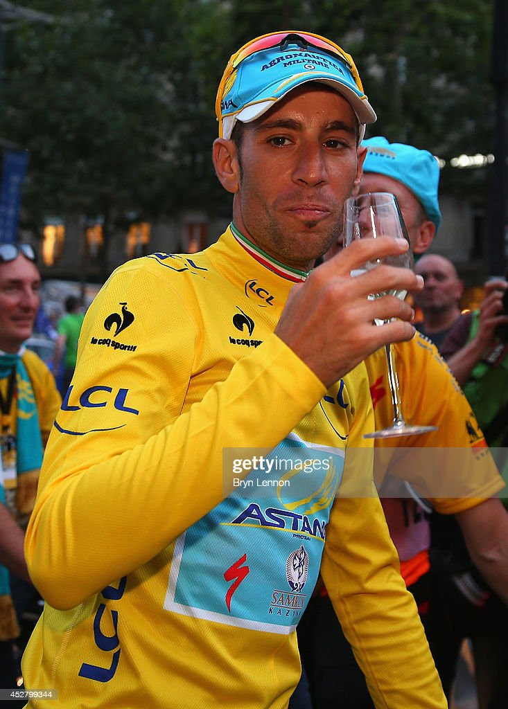 <a gi-track='captionPersonalityLinkClicked' href=/galleries/search?phrase=Vincenzo+Nibali&family=editorial&specificpeople=770634 ng-click='$event.stopPropagation()'>Vincenzo Nibali</a> of Italy and Astana Pro Team celebrates victory with a glass of champagne following the twenty first stage of the 2014 Tour de France, a 138km stage from Evry into the Champs-Elysees, on July 27, 2014 in Paris, France.