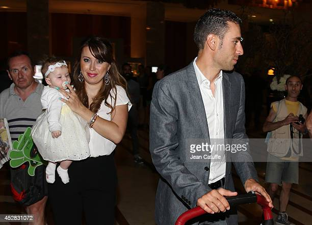 Vincenzo Nibali of Italy and Astana Pro Team his wife Rachele Perinelli Nibali and their baby daughter Emma Nibali leave their hotel on their way to...