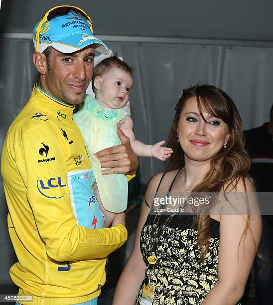 Vincenzo Nibali of Italy and Astana Pro Team poses with his wife Rachele Perinelli and their baby daughter Emma Nibali following the twenty first and...