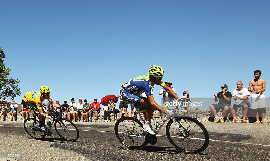 <a gi-track='captionPersonalityLinkClicked' href=/galleries/search?phrase=Vincenzo+Nibali&family=editorial&specificpeople=770634 ng-click='$event.stopPropagation()'>Vincenzo Nibali</a> of Italy and Liquigas-Cannondale leads yellow jersey <a gi-track='captionPersonalityLinkClicked' href=/galleries/search?phrase=Bradley+Wiggins&family=editorial&specificpeople=182490 ng-click='$event.stopPropagation()'>Bradley Wiggins</a> of Great Britain and SKY Procycling on the descent of the Col de Peyresourde on stage sixteen during the 2012 Tour de France from Pau to Bagneres-de-Luchon on July 18, 2012 in Bagneres-de-Luchon, France.