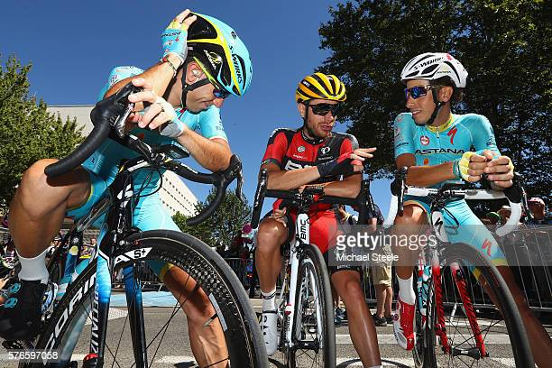 Vincenzo Nibali of Italy and team mate Fabio Aru of Italy and Astana Pro Team talk with Damiano Caruso of Italy and BMC Racing Team ahead of the 2085...